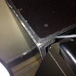 Broken side table. If you are a bumpy sleeper, you might get your hand caught in the furniture