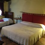Double bed and an extra single bed within the room
