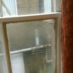 mouldy dirty bodged up window