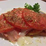 Veal ala Carlos - sauteed veal, ham,mozzarella and tomatoes, baked and oh so yummy.