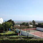 View over the tennis courts to the Mediterranean