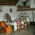 Stabledwellers cottage - they had more money - note floor and bedstead