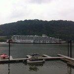 steamboat going past restaurant