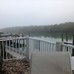 Misty morning view of pier off patio of condo