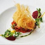 Crab cake, pepper and fennel stew
