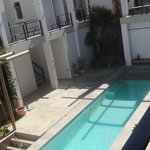Swiming pool with bedroom balconies on upper floor from our balcony