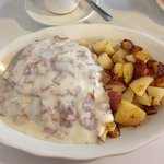 Creamed chipped beef and home fried potatoes.
