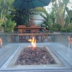 Fireplace in garden patio with coffee bar & hotel.