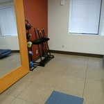 An area across from a row of treadmills and ellipticals