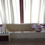 bathtub with curtains for privacy, opens and looks into the ocean