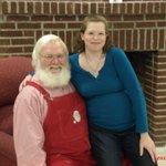 My pregnant self on Santa's lap at Santa's Candy Castle!
