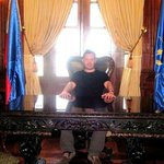My fiancé sitting on Pres. Marcos's desk. No, he's not going to declare the Martial Law. :P