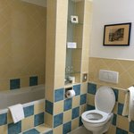 Large/spacious bathroom, two small steps to get in and out of bath/shower combo, heated towel ra