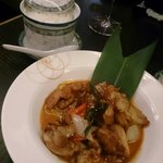 Red Thai curry and side portion of rice - beautifully cooked