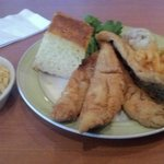 Fried fish with corn bread, house potatoes, and mac n cheese