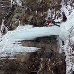 Rappelling down to the frozen river.