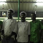 The staff of Spicegarden Restaurant, with the owner (second from the right)
