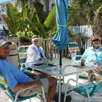 Guests enjoying pool area in the sunshine