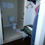 bathroom,  closet area with iron and board