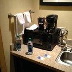 microwave - coffee pot - mini fridge and sink area
