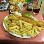 Battered haddock & chips with complimentary gerkin & onion (& onion rings in the background)