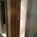 Horrible plastic concertina toilet door (no noise protection)