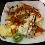 Apfelstrudel with vanilla icecream, cream and fruits (€5.90)