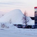 Picture of huge snow pile across from hotel entrance