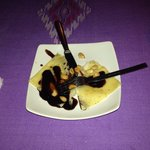 Dessert - Pancakes (crepe) with chocolate sauce and toasted almonds