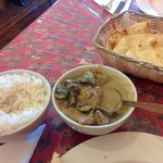 Chicken in almond sauce, rice, and garlic naan