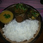 Lentils with garlic, pork bhutuwa, potato and chickpeas..