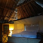 Upstairs bed with mosquito net
