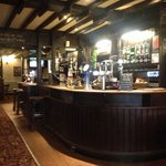 The traditional pub style bar area within The Grapes Hotel.