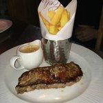 Gold seal Scottish sirloin served with hand cut chips and a cracked black pepper brandy sauce !