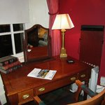 desk with lamp and whats on guide, dated 2012