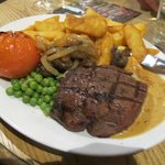 Perfectly cooked steak& chips served in the bar