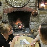 Eating in front of a roaring log fire (with dog under the table)