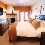King bed with fireplace and hugest bathroom ever.