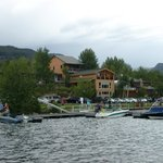 View from water of lower small lakeside cabins & upper large lakeside cabins
