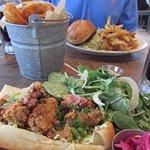Drake's Bay oyster po'boy, bucket of onion rings, burger