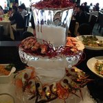 the ice sculpture filled wth prawns and lobsters