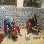 Ladies pressing argan seeds