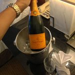 ROOM SERVICE CHAMPAGNE, CHARGED FOR IT, and took it back unopened.