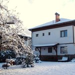 Snow Covered Chalet Levente