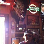 im standing under a huge bison.