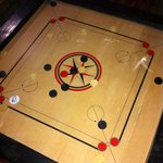 Playing Carrom!