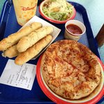 Cheese pizza with Caesar salad and an order of breadsticks