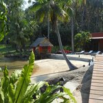 The small beach and relaxing pergola with Thai cushions. Restaurant just to the right