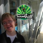 Son JJ at the door of Joes Farm Grill