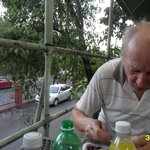 DH enjoying his meal, overlooking the street